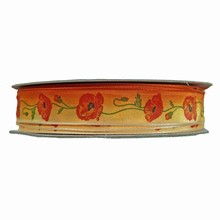 'Ombré' orange ribbon with poppy motif