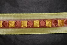 Lime ribbon with geometric motifs in yellow and brown