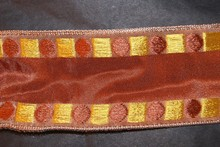 Brown ribbon with geometric motifs in brown and yellow