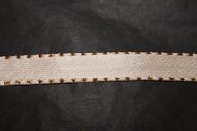 Cream ribbon with metallic gold border