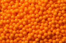 Decorative orange sugar pearls