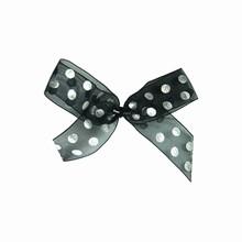 bow15 Boucles sur attaches à pois métalliques sur noir
