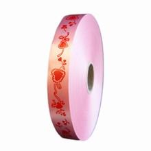 Ruban polypropylène coeurs rouge sur rose